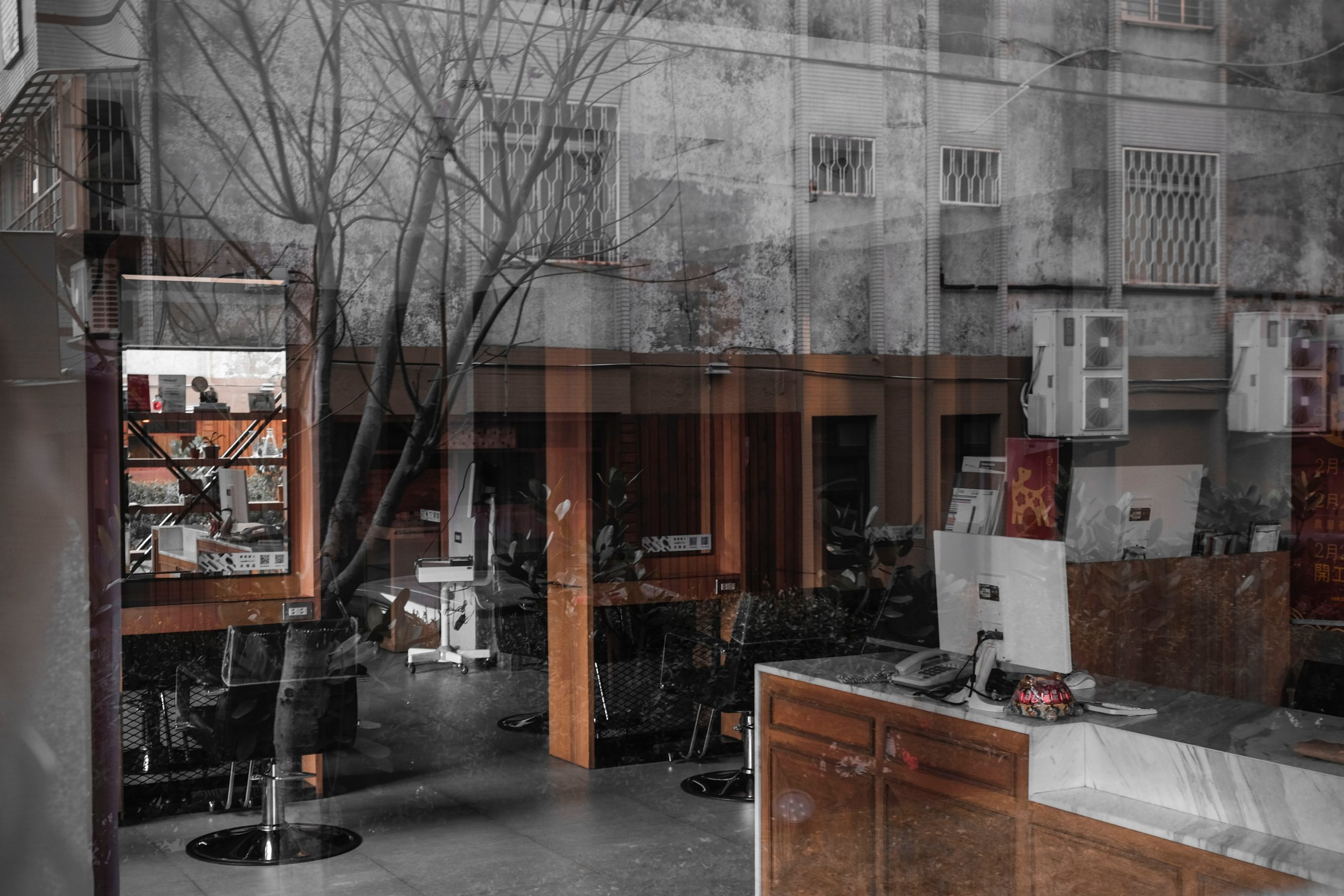 Double-exposure image of interior and exterior of office building.