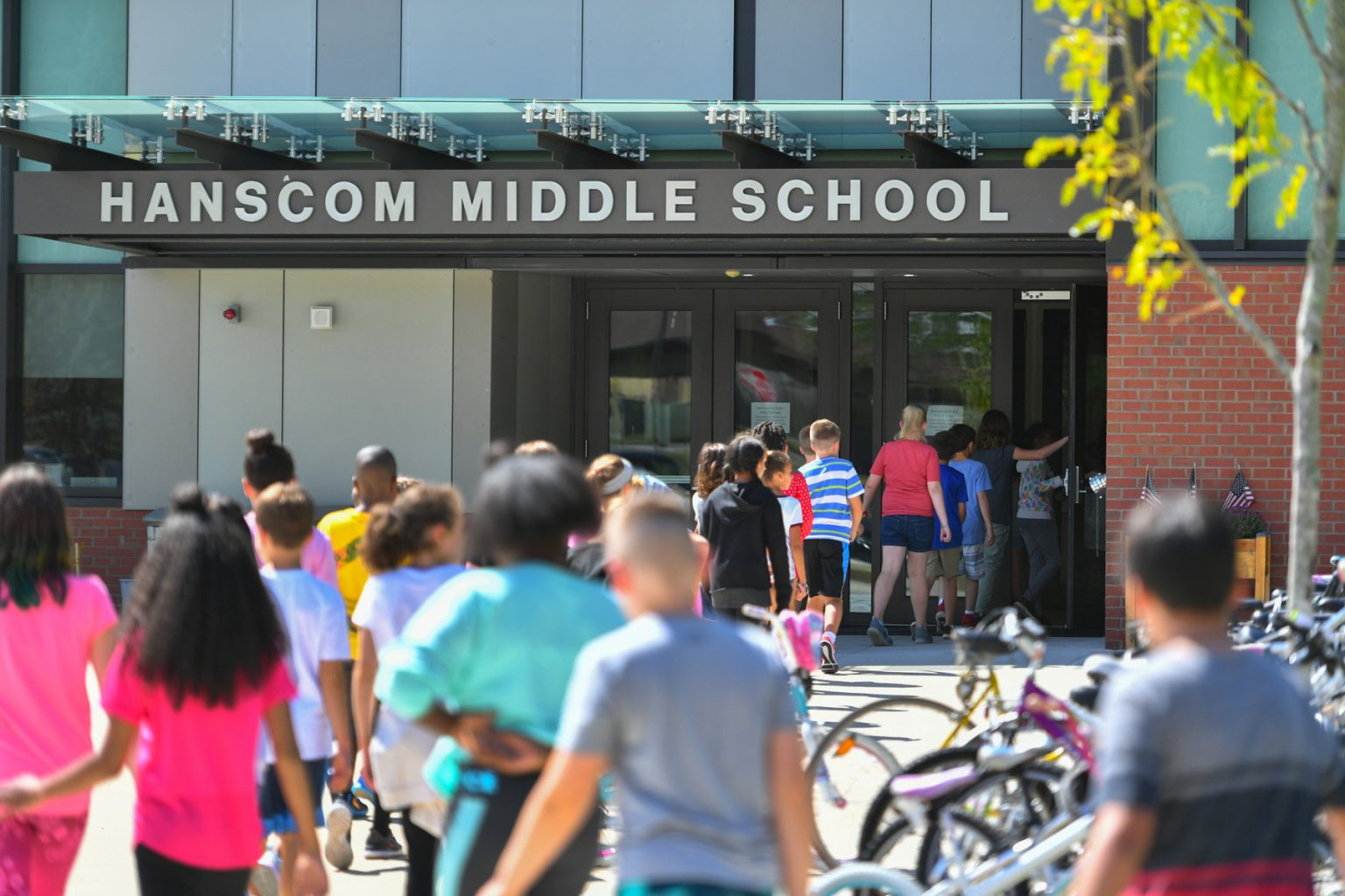 Students file into middle school.